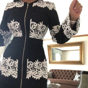 International concept black and white lace jacket.